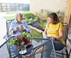 Emily a Resident at Eden Care Home back patio on the left and her Daughter Kay Harsha.